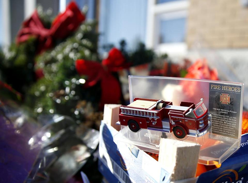 Worcester, MA, 12/10/2018 -- A toy firetruck was placed at a makeshift memorial in tribute to fallen firefighter Christopher J. Roy outside of his fire station. (Jessica Rinaldi/Globe Staff) Topic: 11worcesterpic Reporter: